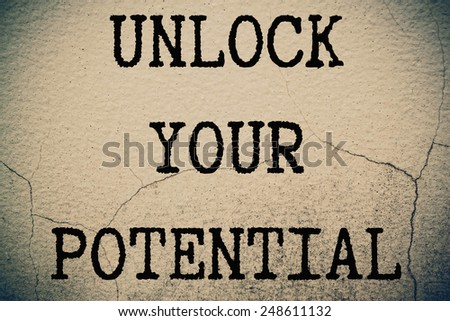 unlock your potential concept write on wall  - stock photo