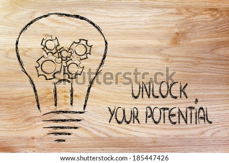 unlock your potential, lightbulb with gearwheels metaphor of success in business - stock photo