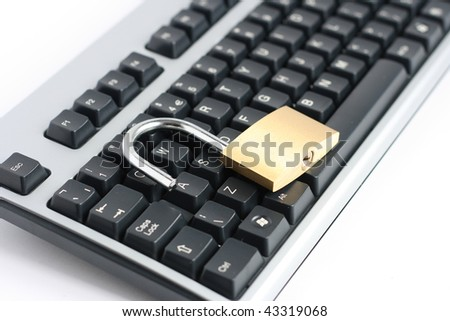 unlocked open padlock with computer keyboard - stock photo