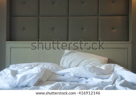 Unmade bed in hotel - stock photo