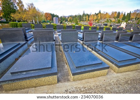 Unmarked and unnamed cemetary marble graves - stock photo