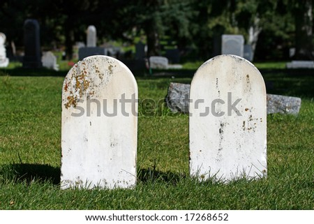 Unmarked Tombstones - stock photo