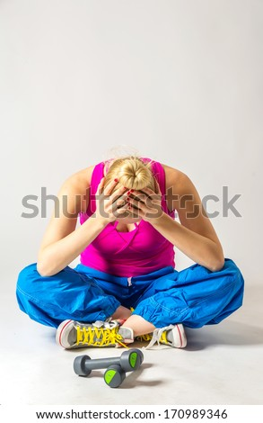 Unmotivated woman with weights