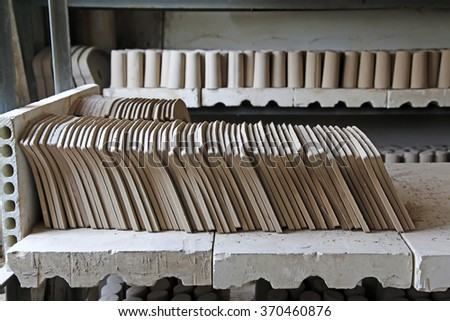 Unpainted clay idol mould in a factory, closeup of photo - stock photo