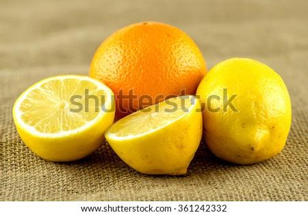 Unpeeled whole orange and lemons - stock photo
