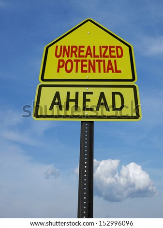 unrealized potential motivational ahead  post sign over blue sky - stock photo