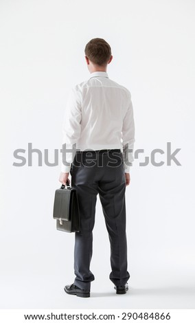 Unrecognizable assured young businessman, rear view - stock photo