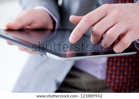 Unrecognizable business man holding a digital tablet - stock photo