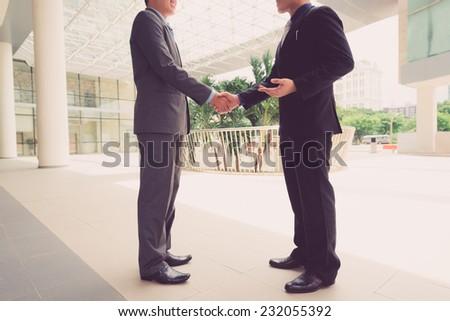 Unrecognizable business partner shaking hands - stock photo