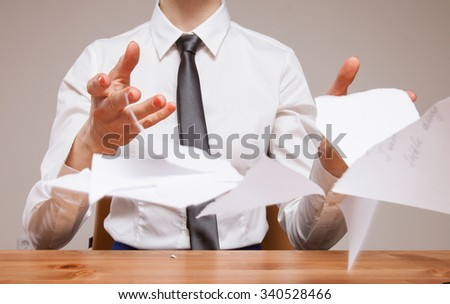 Unrecognizable business woman throwing disrupt documents, closeup shot - stock photo