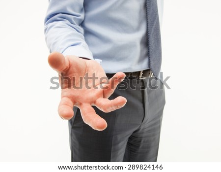 Unrecognizable businessman showing an unpleasant demanding gesture, white background - stock photo