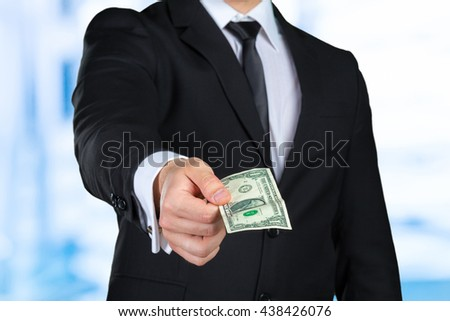 Unrecognizable businessman shows dollar banknote - stock photo