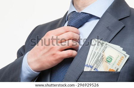 Unrecognizable businessman with dollars in the pocket