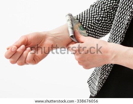 Unrecognizable businesswoman hiding money in the sleeve, closeup shot