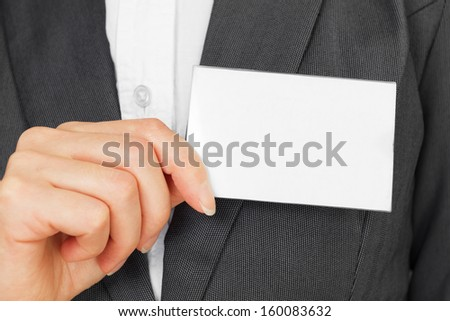 Unrecognizable businesswoman hold badge card on the chest, copy-space - stock photo