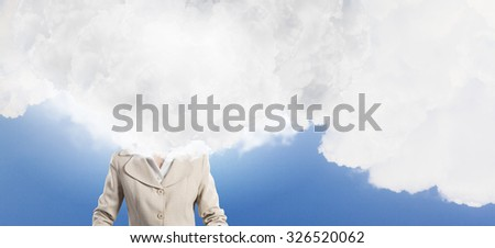 Unrecognizable businesswoman with cloud instead of head