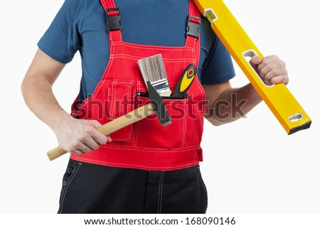 Unrecognizable construction worker in uniform with special tools