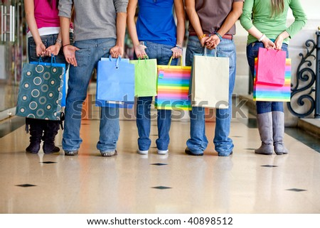 Unrecognizable group of people with shopping bags - stock photo