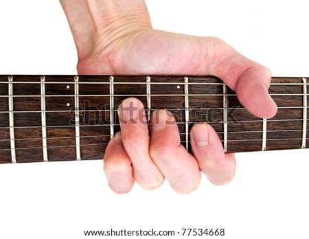 unrecognizable guitarist hand playing chord on musical  guitar instrument. white background. - stock photo