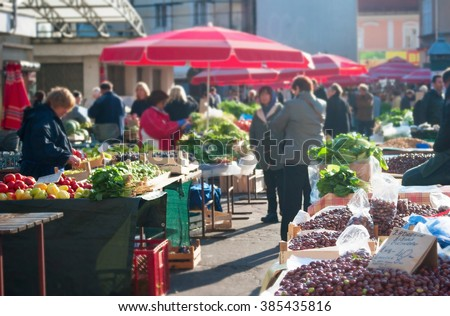Unrecognizable people at a food market in Zagreb, Croatia - stock photo