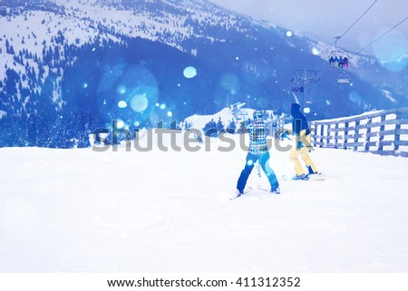 unrecognizable people skiing in the snow in the winter