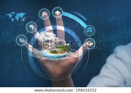 Unrecognizable person working with holographic city plan - stock photo