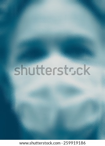 Unrecognizable physician wearing mask behind glass, blurred effect - stock photo