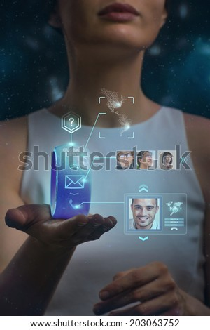 Unrecognizable woman holding wearable gadget. New technologies. Wireless tools. Future communications and social media concept. - stock photo