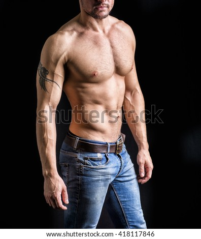 Unrecognizable young man with naked muscular torso - stock photo