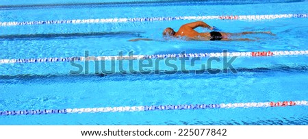 Unrecognized person swim in swimming pool. Background texture. concept photo water, sport, swimming. - stock photo