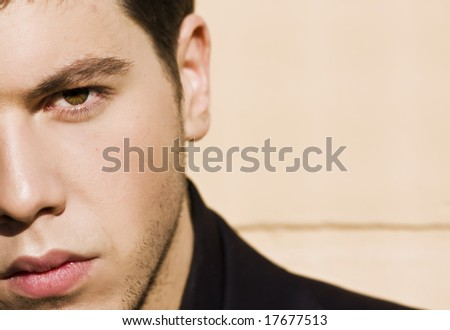 Unshaved handsome man close portrait. - stock photo