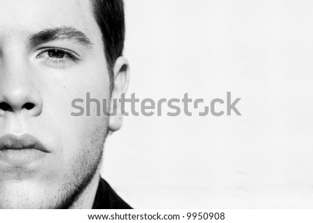 Unshaved handsome man portrait in black and white. - stock photo