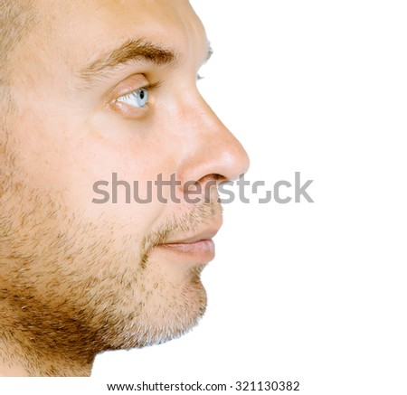 Unshaven blue eyed middle-aged man in profile. Studio. isolated