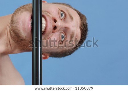 unshaven man bite a pipe - stock photo