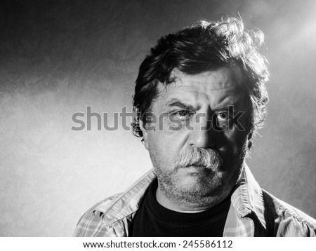 unshaven man, black and white - stock photo