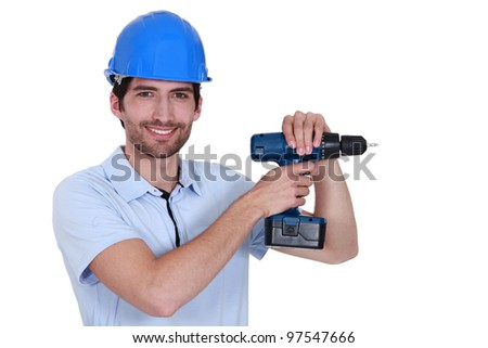 Unshaven worker with power drill - stock photo