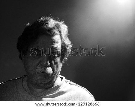 unshavng middle-aged man, black and white - stock photo