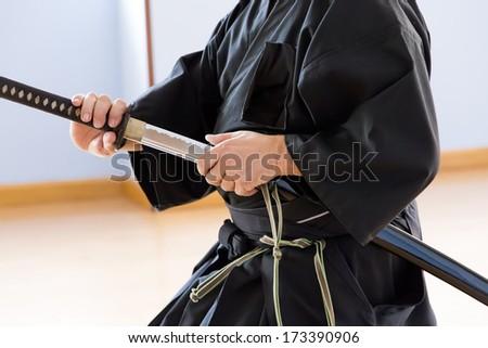 unsheathing katana - stock photo