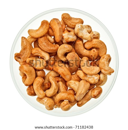 Unshelled cashew nuts in a glass bowl isolated on white - stock photo