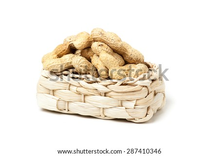 unshelled peanuts peanuts isolated in basket on white background - stock photo