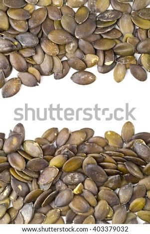 Unshelled pumpkin seeds border frame background - stock photo