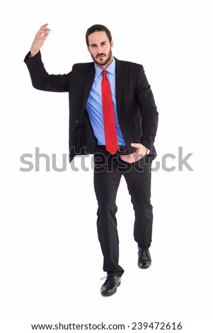 Unsmiling businessman holding something with hands on white background - stock photo