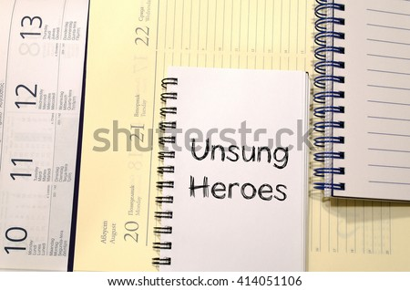 Unsung heroes text concept write on notebook
