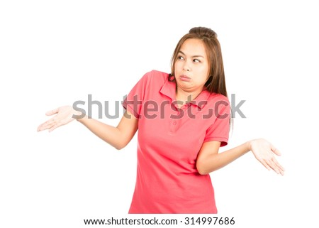 Unsure and indifferent Asian woman dressed in casual clothes, frowning, throwing hands up, shrugging shoulders with attitude of uncertainty, indecision, apathy, or who cares