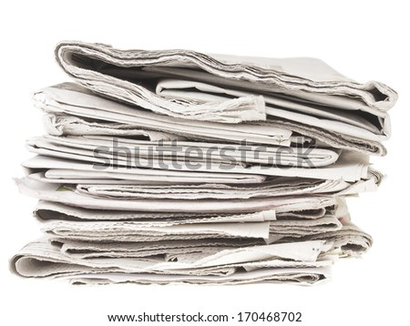 untidy pile of old folding newspapers on white background - stock photo