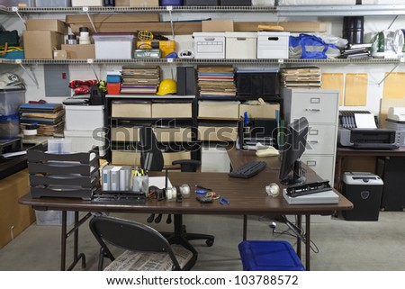 Untidy shop space office with boxes, files and clutter - stock photo