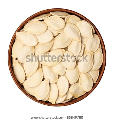 Untreated seeds of pumpkin in a bowl, isolated, white background. - stock photo