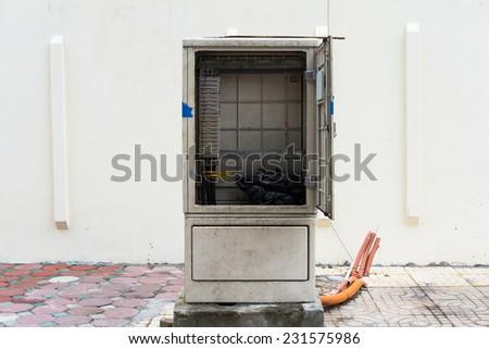 Unused electric cabinet on sidewalk in Hanoi - stock photo