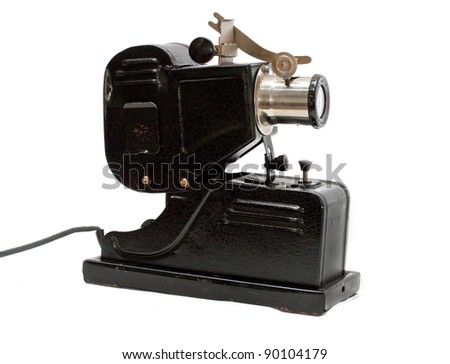 Unusual  and within old-styled film camera isolated on white - stock photo