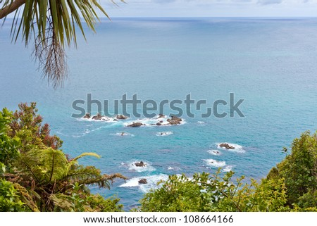 Unusual calm Tasman Sea at West Coast of South Island of New Zealand - stock photo